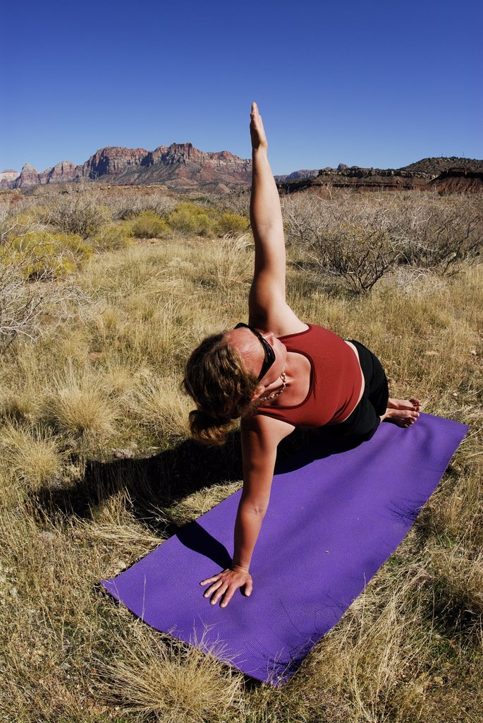 Stock Photo: 1778-12303 A woman doing yoga outside in Springdale, Utah