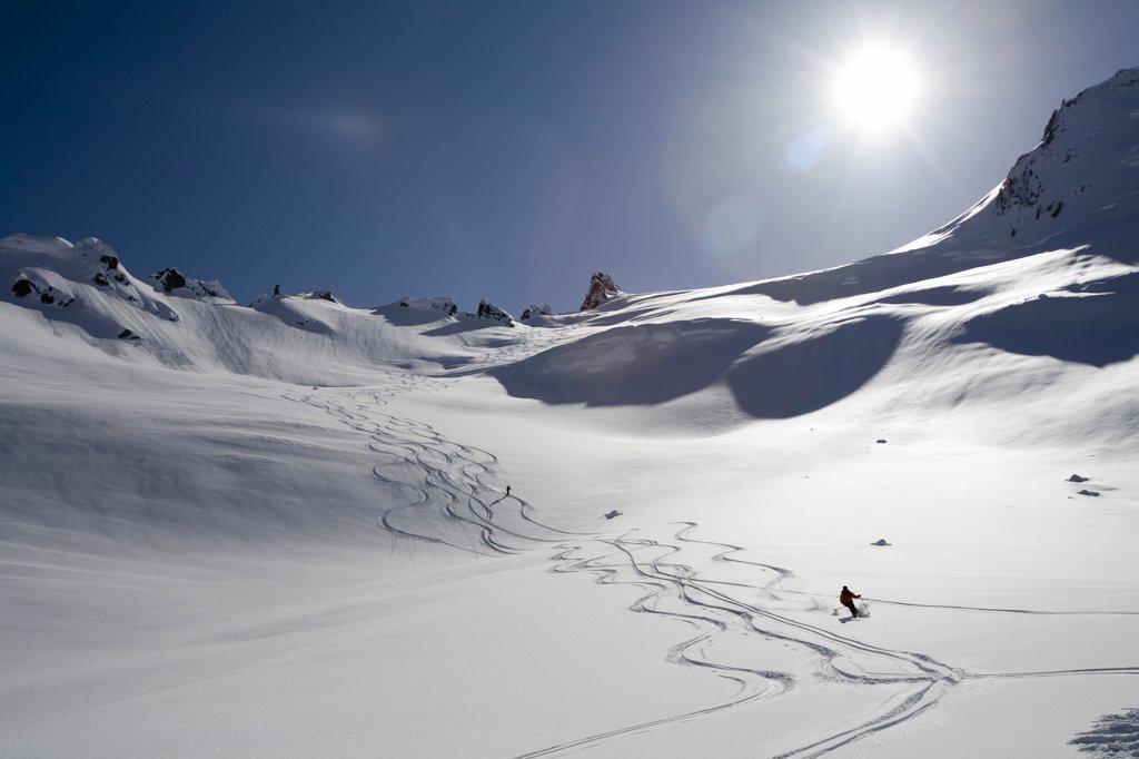 Stock Photo: 1778-12421 Man skis down hill in Alaska backcountry near Alaska Canada border