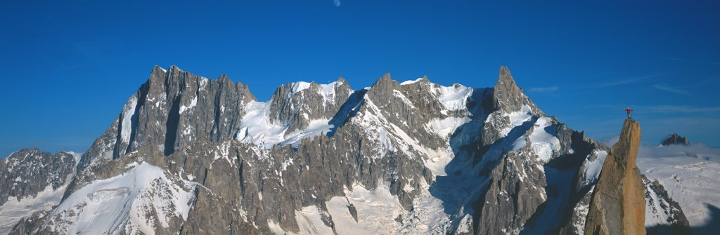 Panoramic of high mountain peaks in the Alps : Stock Photo