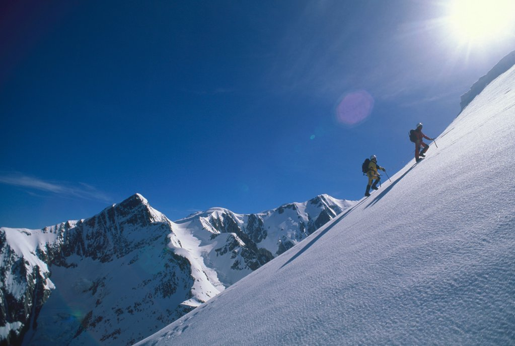 Two climbers on the Mettrier ridge Northen face of Dôme de Miage : Stock Photo