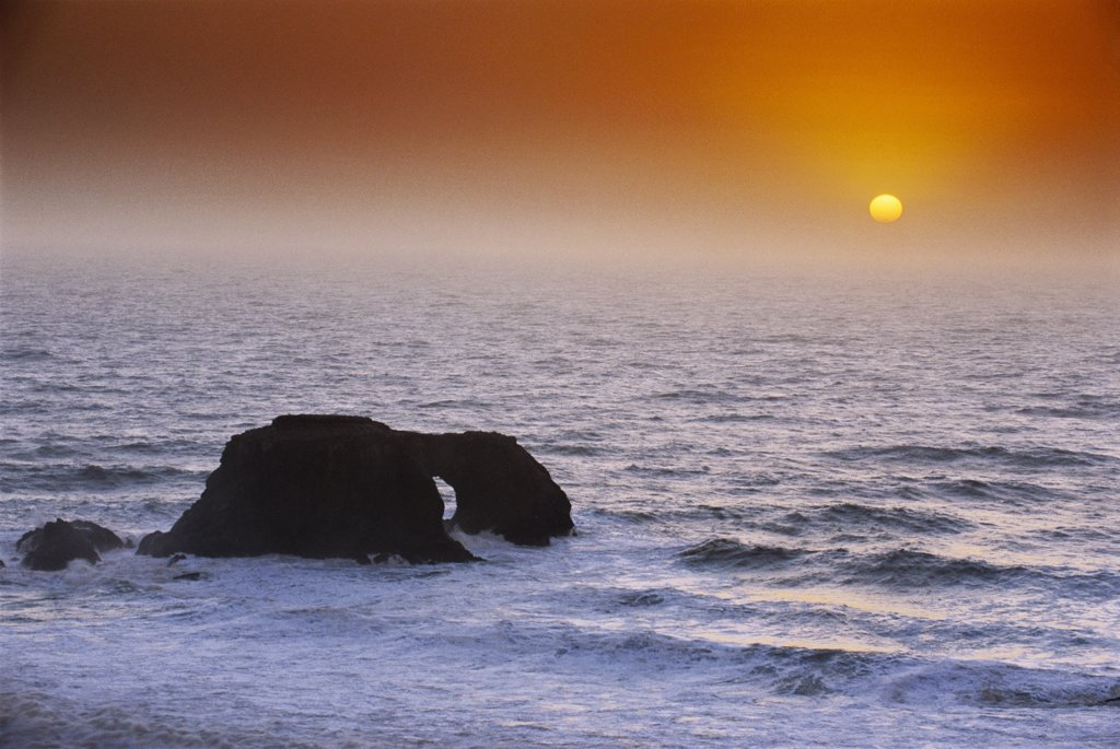 Arched Rock and Ocean Sunset : Stock Photo