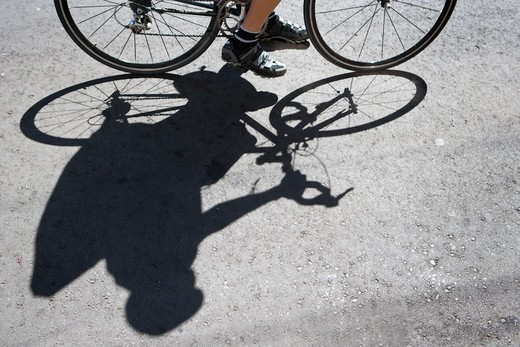 Stock Photo: 1778-13936 The shadow of a cyclist-bike messenger in San Francisco, California