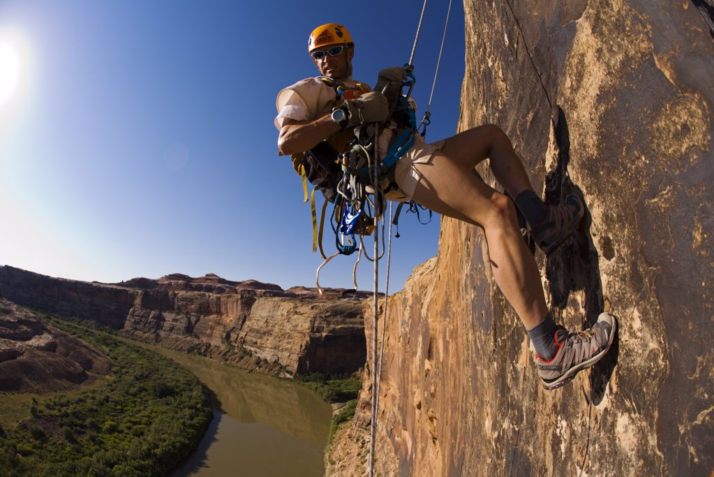 Adventure racer rappelling over a river in a race in Moab, Utah : Stock Photo