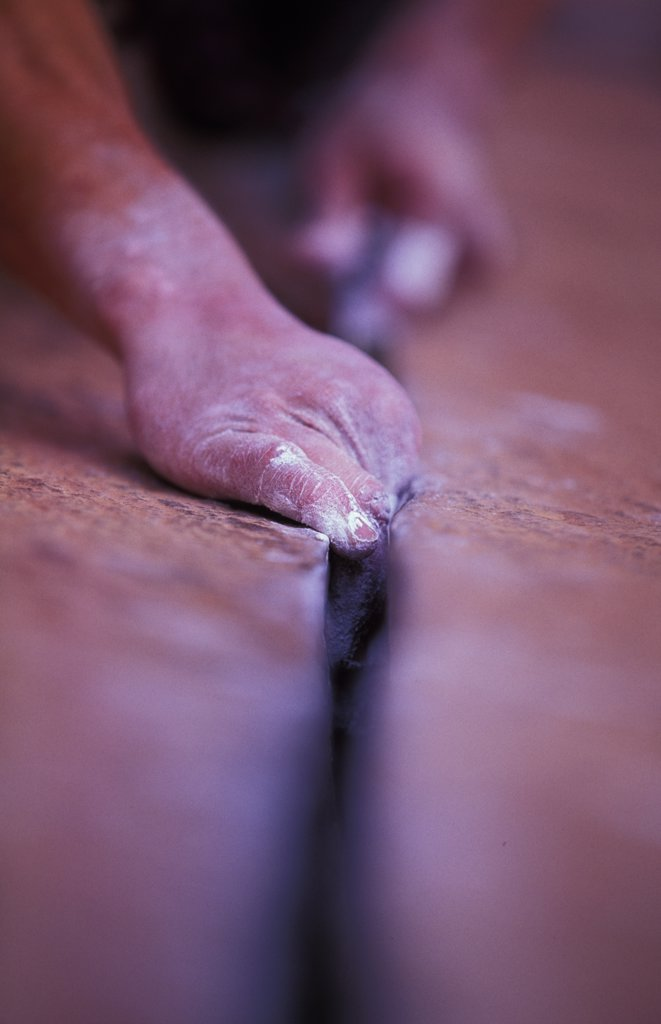 Stock Photo: 1778-14896 Hands in a crack while crack climbing (Selective Focus)