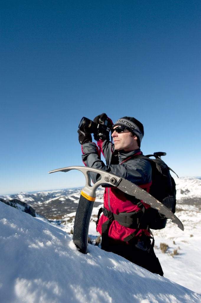 A photographer photographs a skier : Stock Photo