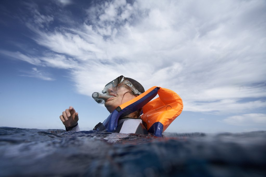 Stock Photo: 1778-7983 Snorkeler breaking the surface