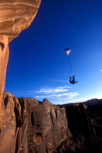 Stock Photo: 1778-8495 Man base jumping off the Tombstone, Utah, USA