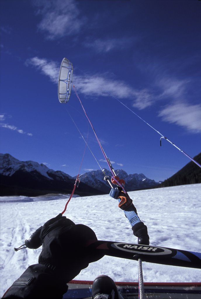 Snow Kiting from the point of view of the kiter Spray Lake, Canada : Stock Photo