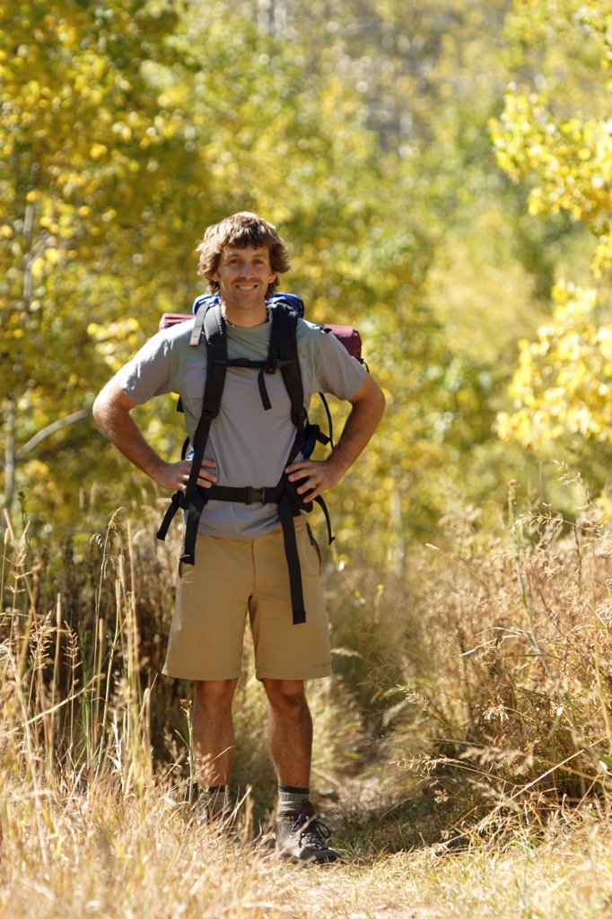 Stock Photo: 1778-9094 Young man backpacking near Fallen Leaf Lake, CA
