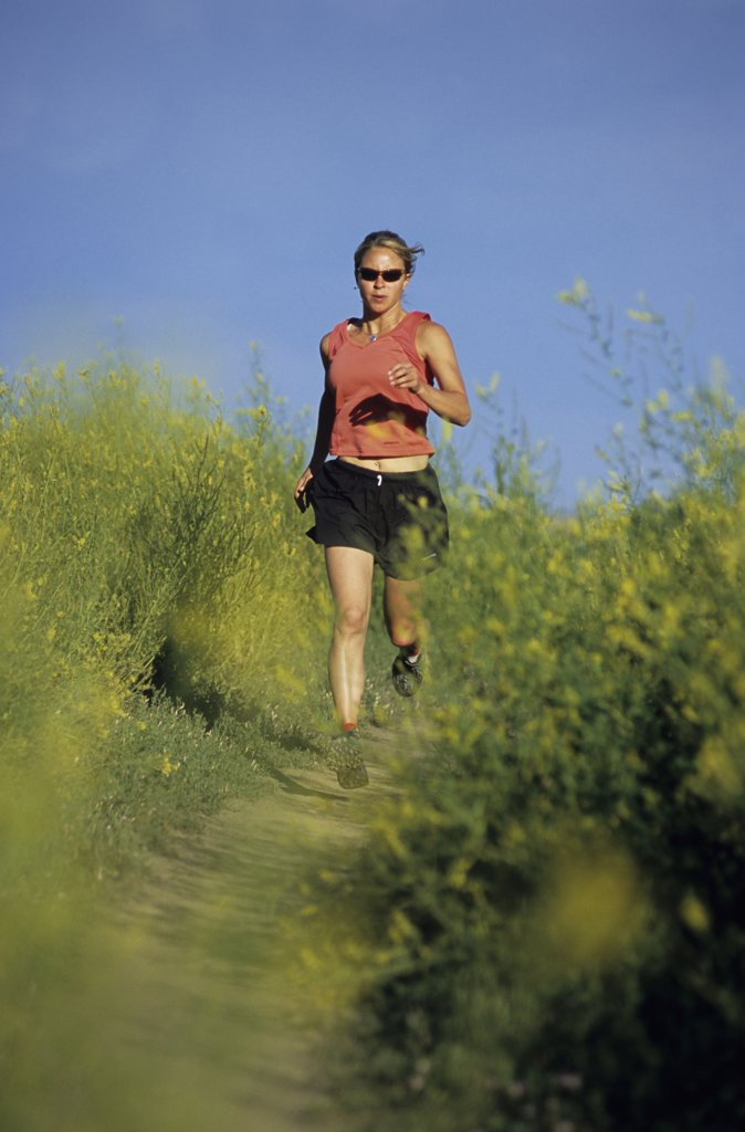 A woman running on the Lefthand trail near Boulder, CO : Stock Photo
