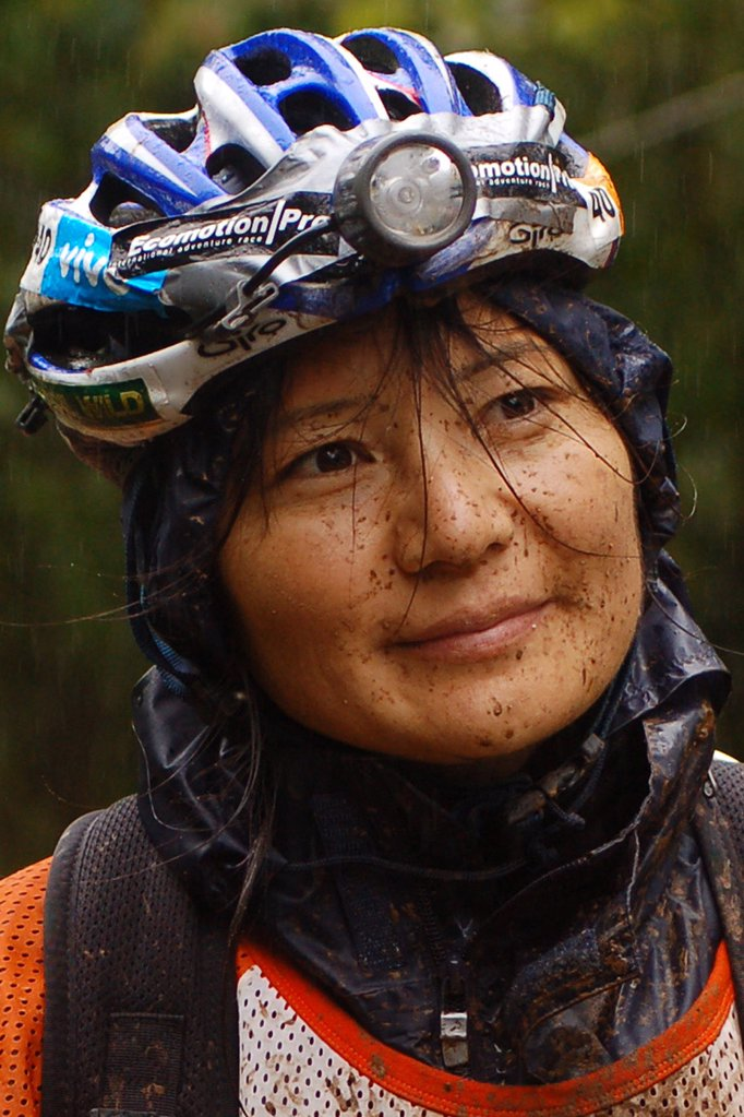 Stock Photo: 1778-9577 A woman wears her adventure racing equipment
