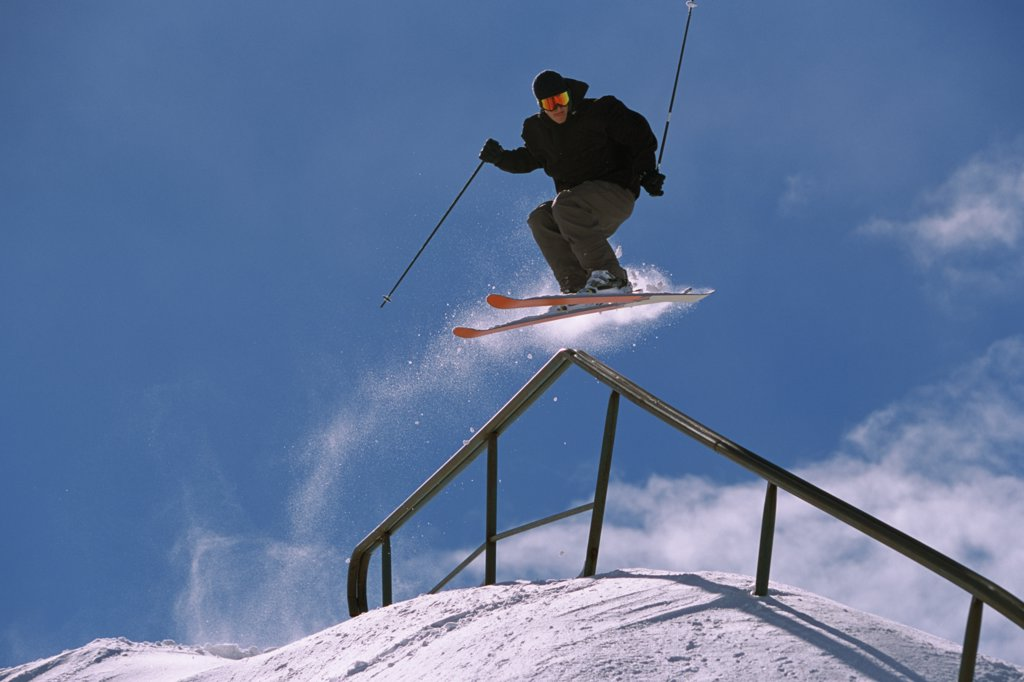 Stock Photo: 1778-9797 A skier does a trick on a handrail