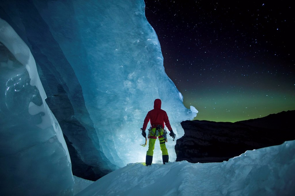 Stock Photo: 1778R-13658863 Ice Climber Standing At Athabasca Glacier During Aurora Borealis