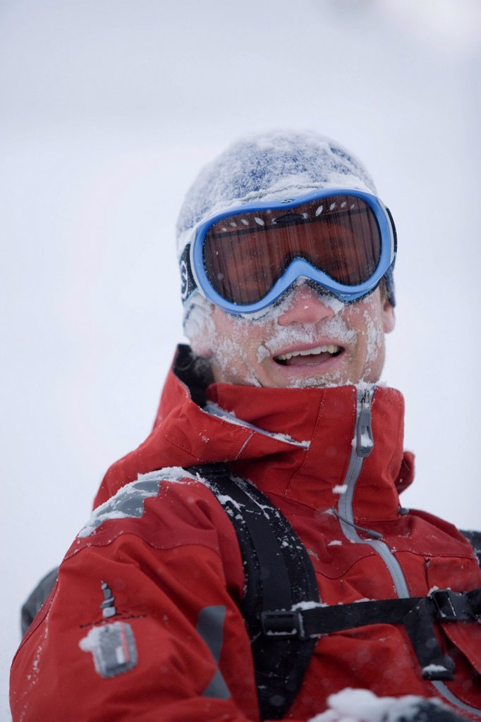 Stock Photo: 1778R-1622 Young man skiing in deep powder.