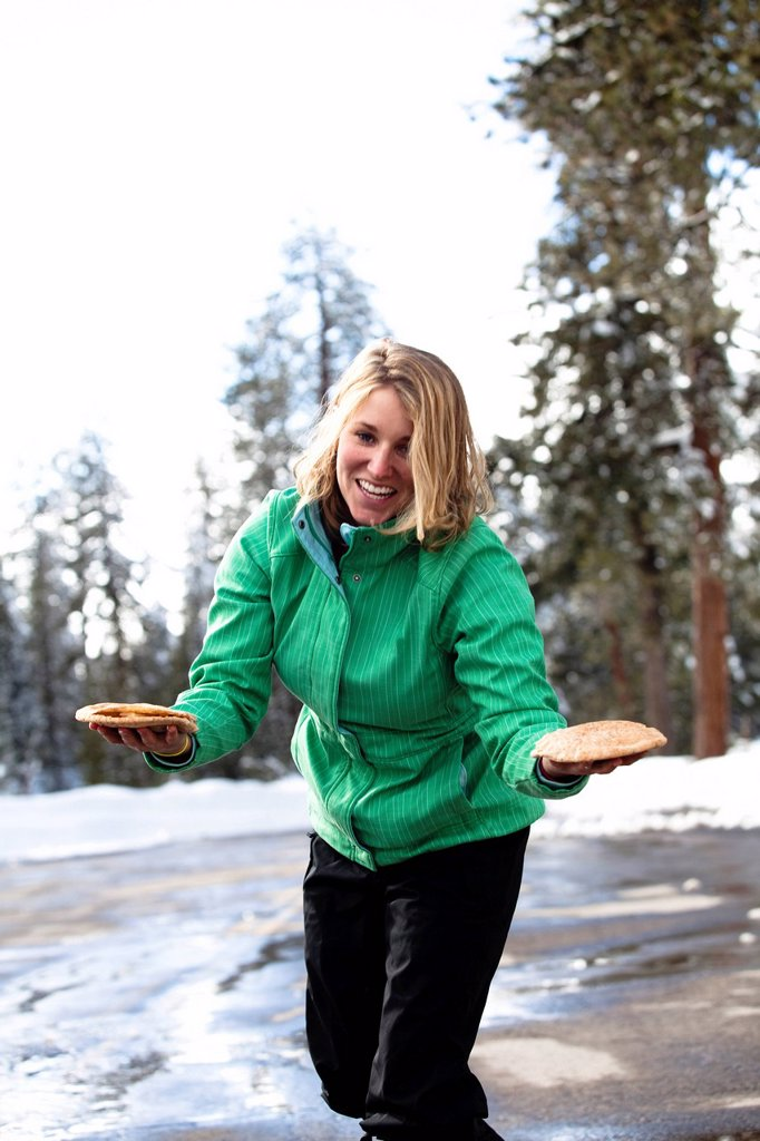 A woman prepares pita bread for lunch in Sequoia National Park, California. : Stock Photo
