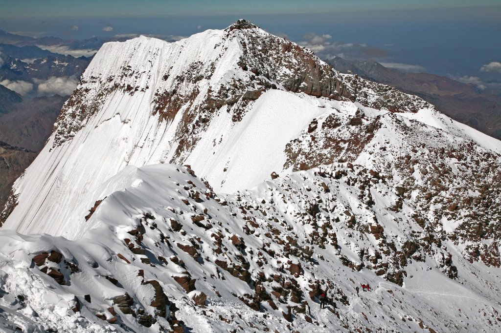 Stock Photo: 1778R-20331 Aconcagua South Summit view and climbers ascending, from Aconcagua main summit at 6962 m.