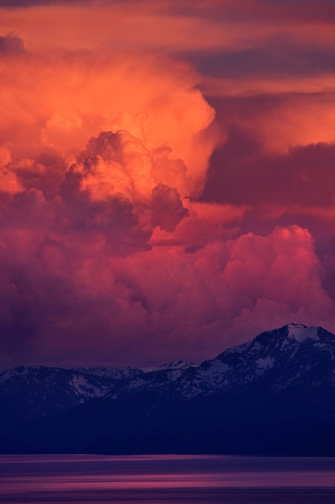 Stock Photo: 1778R-20441 Pink, orange and red thunderheads over Lake Tahoe and the Sierra mountains in the evening