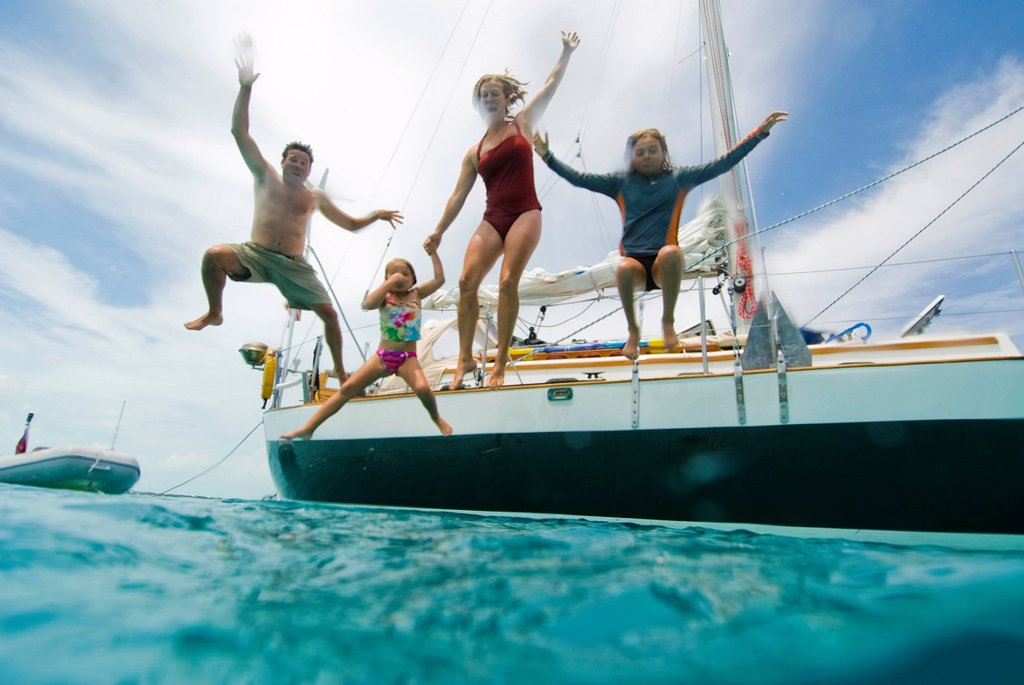 Stock Photo: 1778R-20576 A family jumping off their boat