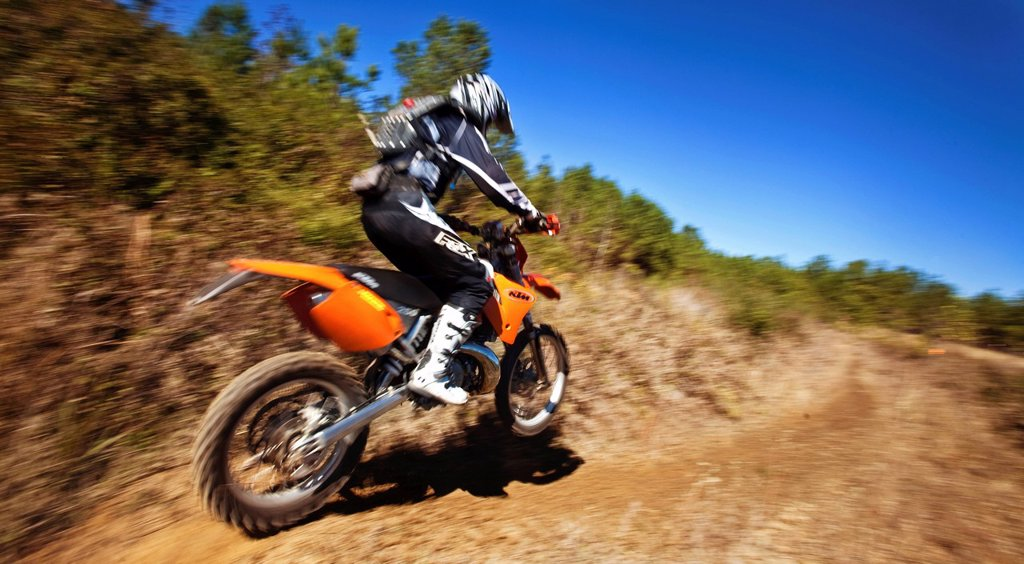 Stock Photo: 1778R-20933 A motorcyclist rides a trail of an Enduro race in Maplesville, Alabama. Motion Blur