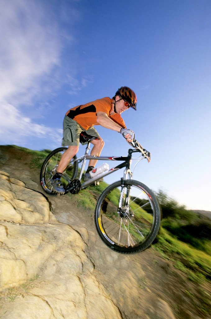 Stock Photo: 1778R-2109 Biker riding in Laguna, California.