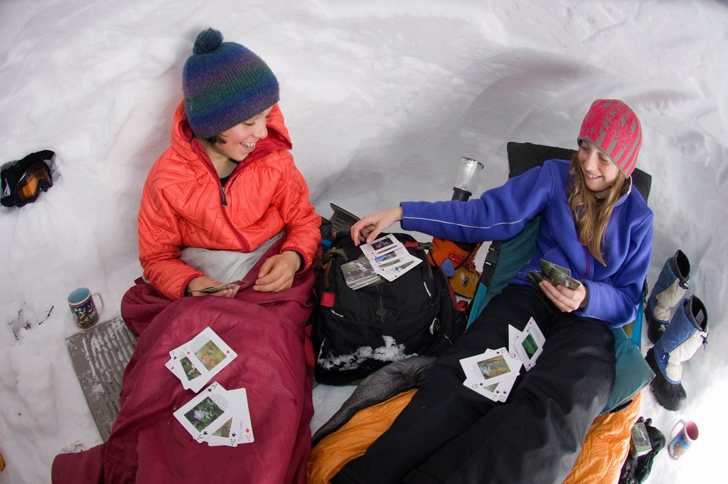 Stock Photo: 1778R-21342 Boy and girl playing cards in snow cave, Silverton, Colorado.