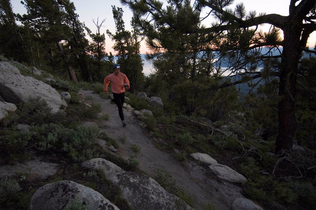 Trail runner with headlamp. : Stock Photo