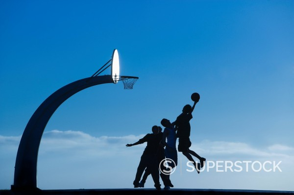 A group of men play basketball. : Stock Photo
