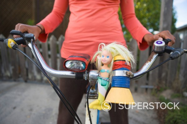 Mermaid doll on beach bike. : Stock Photo