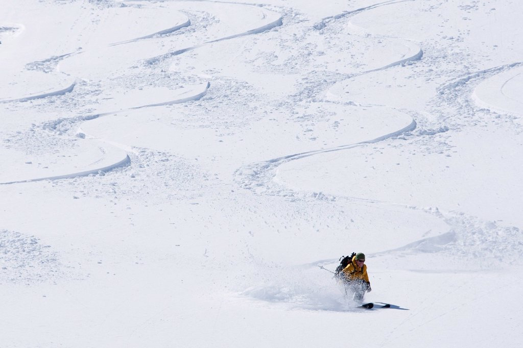 Stock Photo: 1778R-27718 One man skiing a new line between other skiers´ tracks.