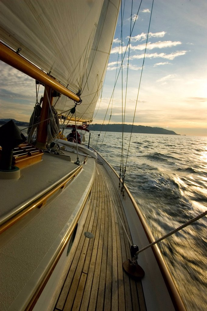 Stock Photo: 1778R-2801 Sunset from the deck of a sailing yacht.