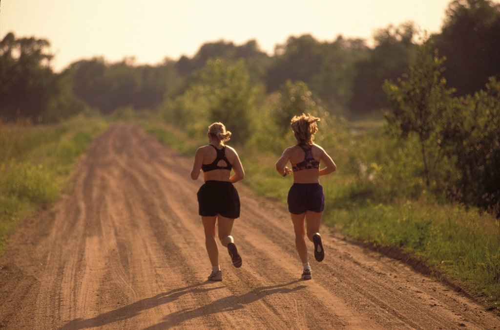 Stock Photo: 1778R-2948 Runners on dirt road jogging.