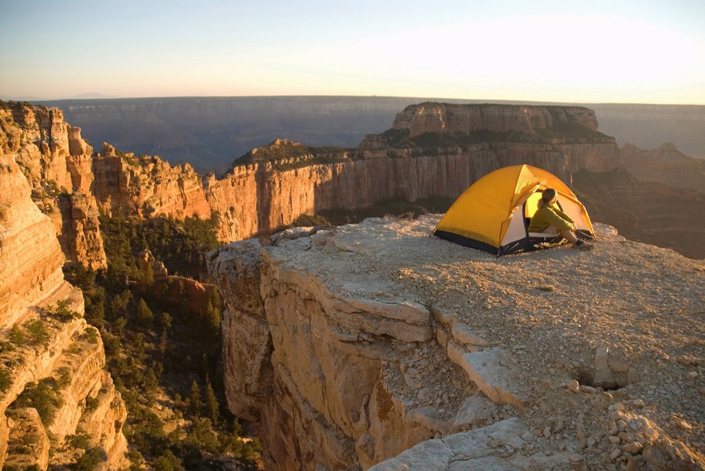 Woman camps in tent, Grand Canyon. : Stock Photo