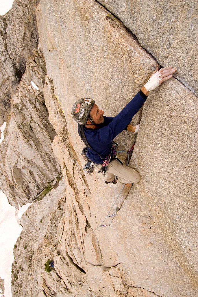 Man climbs the last pitch. : Stock Photo