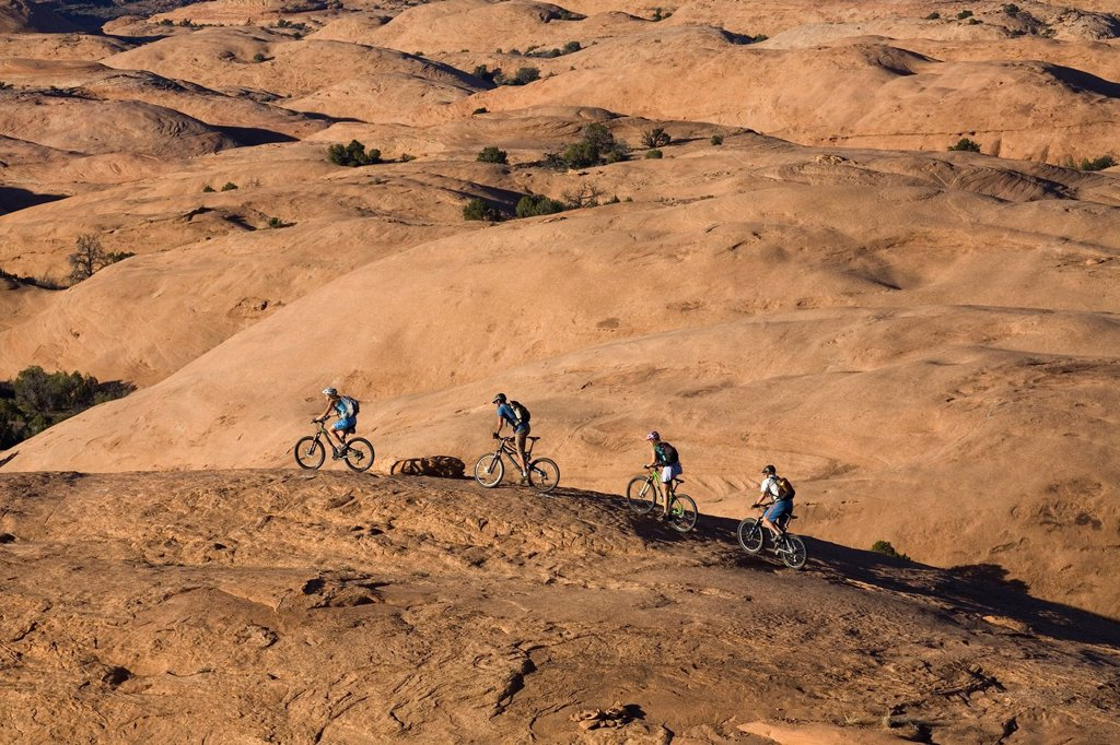 A group mountain biking in Moab, Utah. : Stock Photo