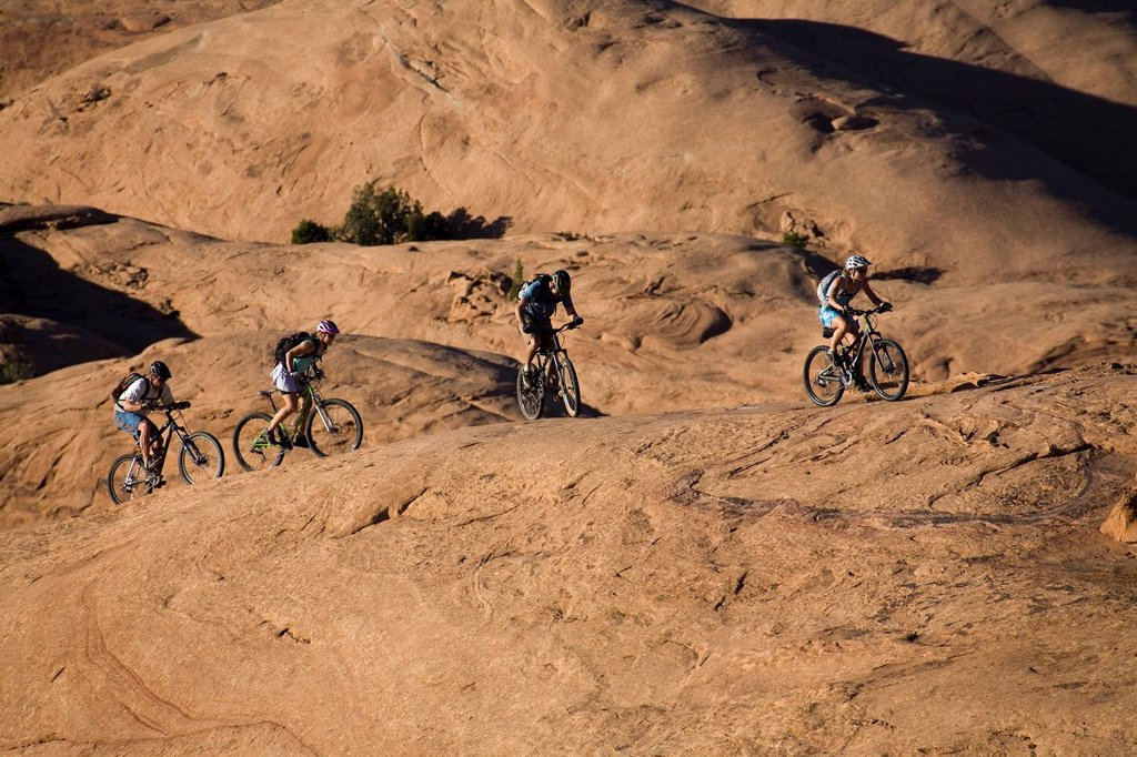 Stock Photo: 1778R-3038 A group mountain biking in Moab, Utah.