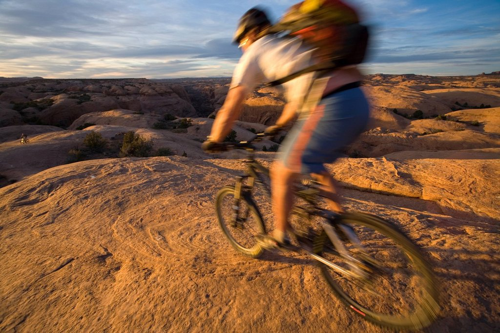 Stock Photo: 1778R-3052 Man mountain biking, Moab, Utah.