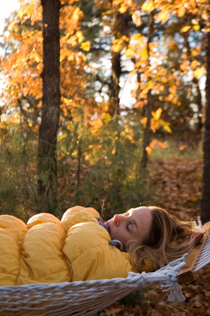 Stock Photo: 1778R-3079 Woman sleeping in hammock.