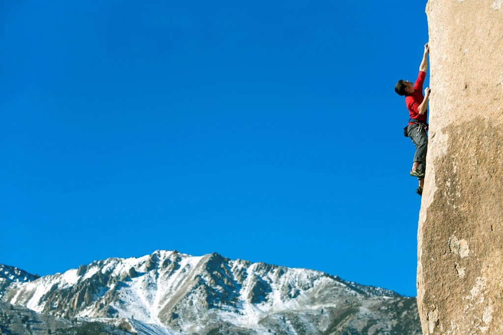 Stock Photo: 1778R-3359 Man lead climbing.