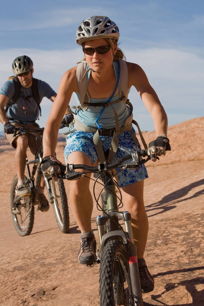 Stock Photo: 1778R-3469 Couple mountain biking, Moab, Utah.