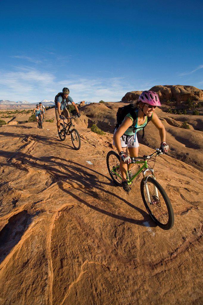 A group mountain biking in Moab, Utah. : Stock Photo
