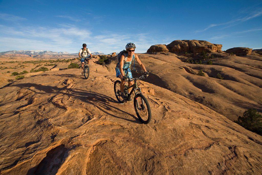 Stock Photo: 1778R-3478 Couple mountain biking, Moab, Utah.