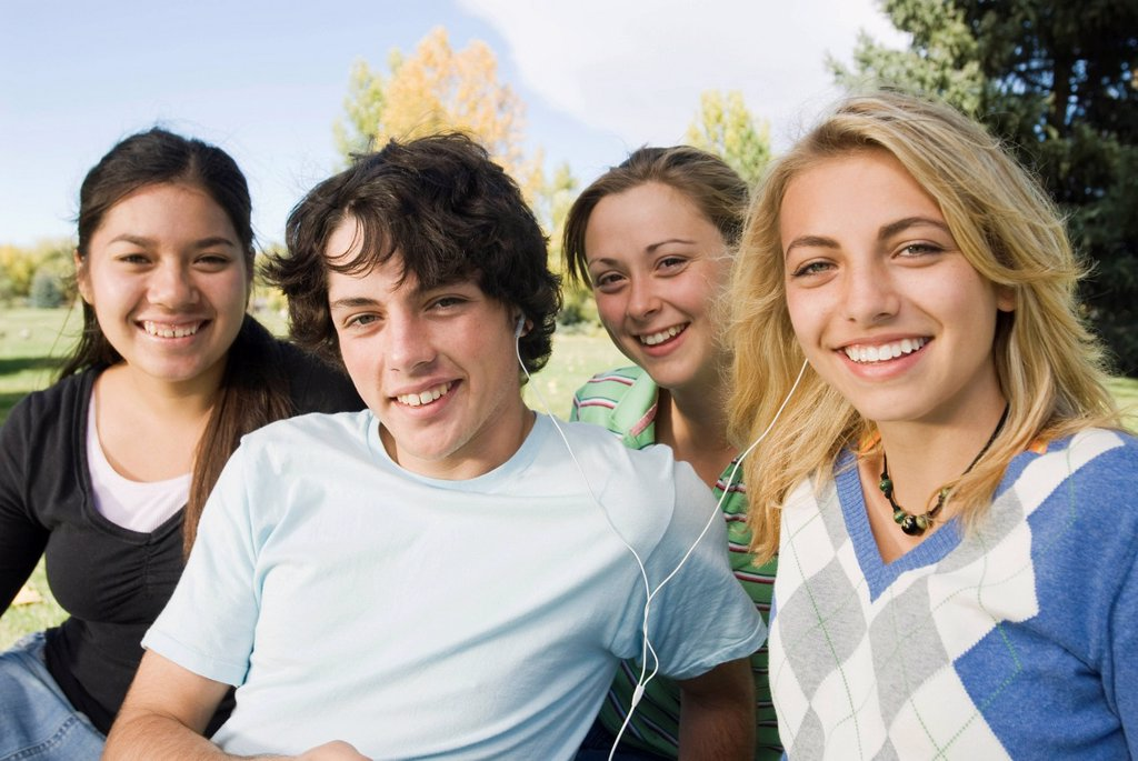 Stock Photo: 1778R-4054 A group of friends listening to music in a park in Fort Collins, Colorado.