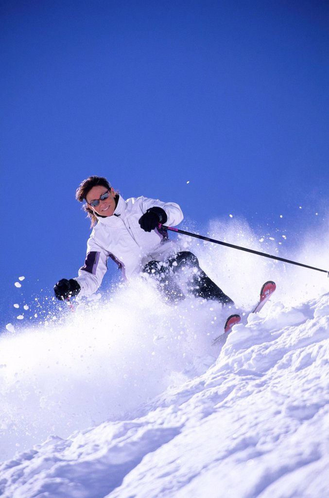Stock Photo: 1778R-4574 Woman skiing in Utah.