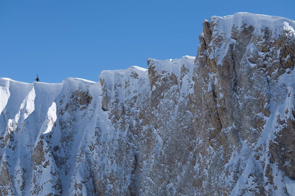 A lone skier hiking on an exposed ridge, Las Lenas, Argentina. : Stock Photo