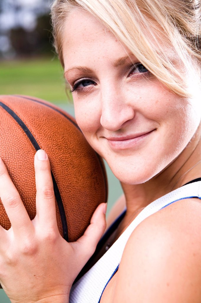 Stock Photo: 1778R-5957 A portrait of an athletic woman playing basketball.