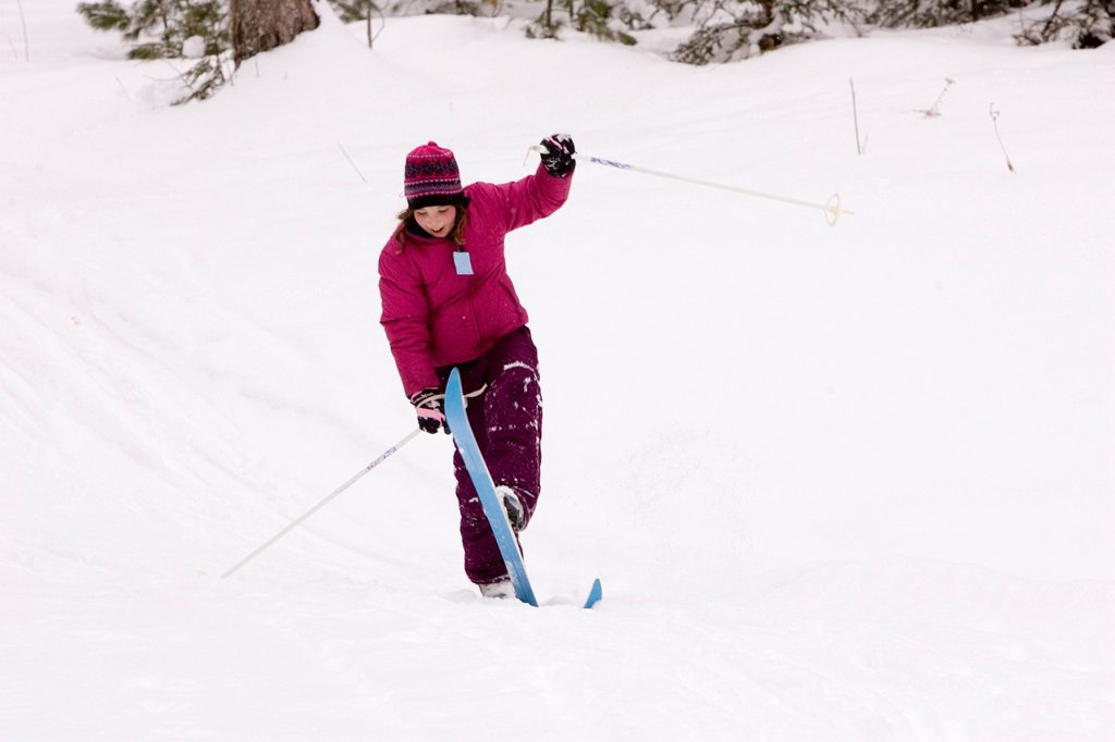 Stock Photo: 1778R-5989 A young girl Cross Country Skiing in Dayton, Maine.