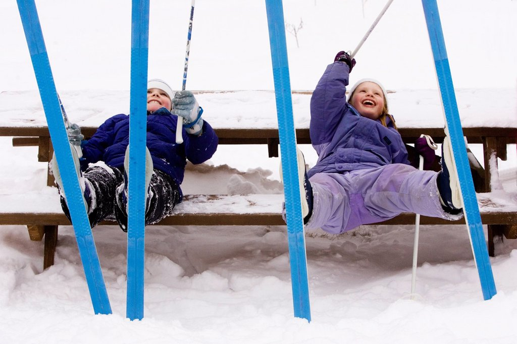 Stock Photo: 1778R-5990 Two young girls rest, while Cross Country Skiing in Dayton, Maine.