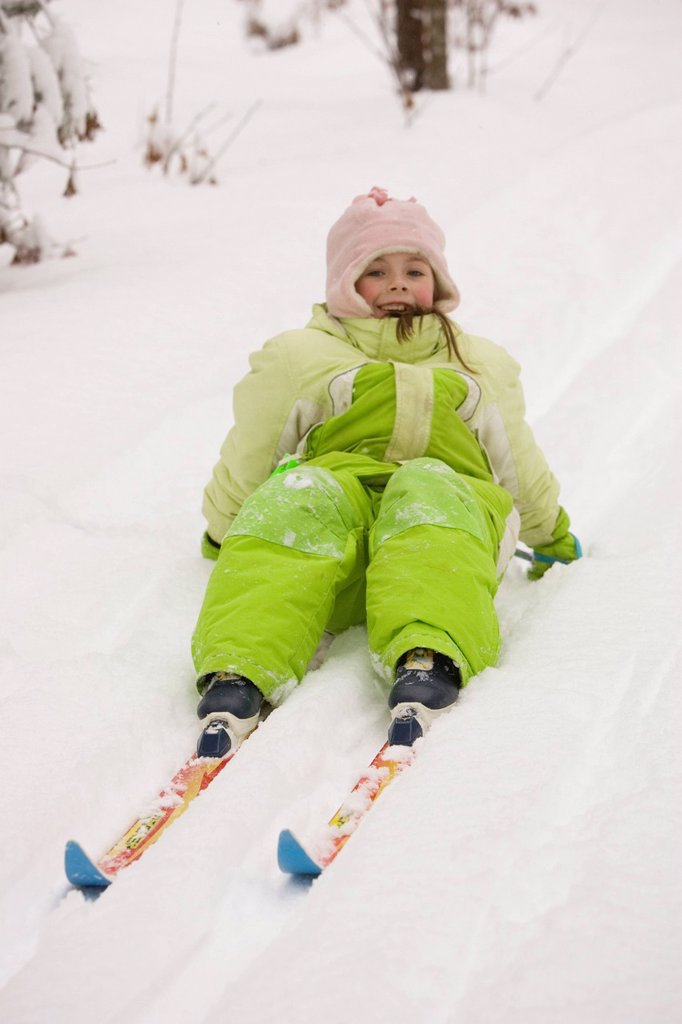 A young girl attempts to get up, while Cross Country Skiing in Dayton, Maine. : Stock Photo