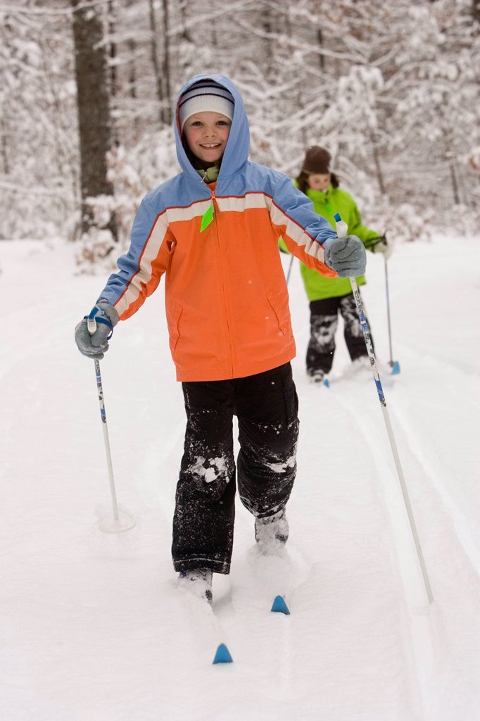 Two young girls Cross Country Skiing in Dayton, Maine. : Stock Photo