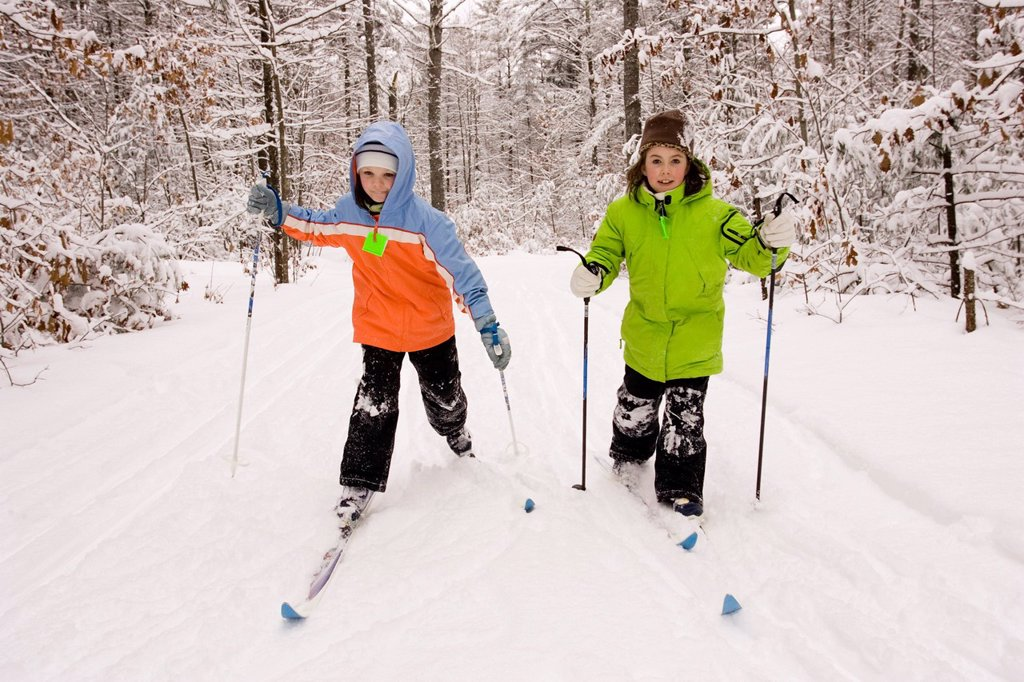 Stock Photo: 1778R-5997 Two young girls Cross Country Skiing in Dayton, Maine.